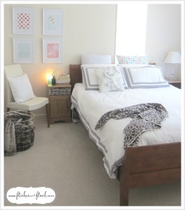 White frames around pops of pink + mint have transformed our guest bedroom.