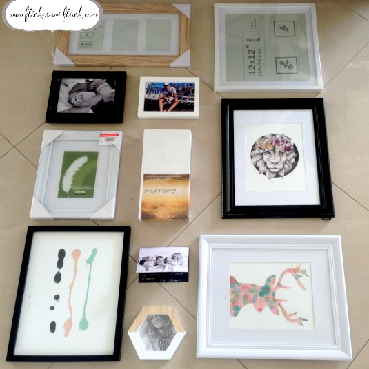 Before you hang all of your images for a gallery wall-style arrangement, play around with the layout on the floor!